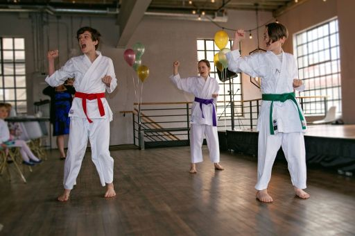 Kazoku Martial Arts demonstrating their amazing karate skills during their Mother's Day High Tea at E.V.O Kitchen.